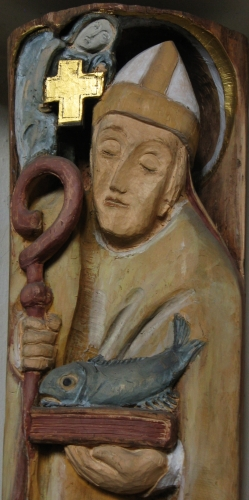 detail of a bas-relief of Saint Ulric of Augsburg by Bernardine Weber, 1982; church of Saint Margaretha in Reichertshofen, Germany; photographed on 22 June 2016 by Klaus Schönitzer; swiped from Wikimedia Commons