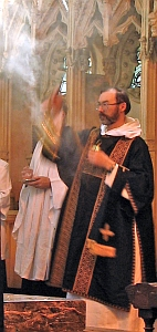 a deacon incensing a priest during Mass; swiped with permission from the flickr account of Father Lawrence Lew, OP