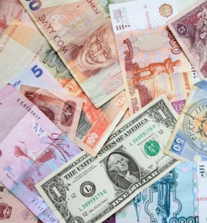 10815090-many-banknotes-of-different-countries-the-background-of-the-bank-notes-currency-in-different-countri-Stock-Photo