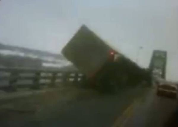 High-Winds-Topple-Truck-On-Bridge