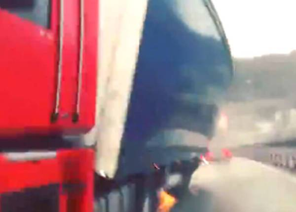 Wind Nearly Blows Triler Over Into Car