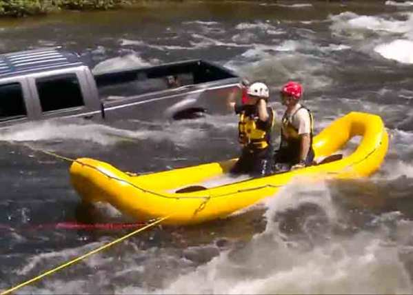 Video: Dog Rescued From Vehicle in Fast-Moving River