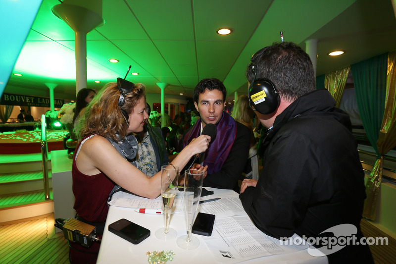 L to R   Jennie Gow  BBC Radio 5 Live Pitlane Reporter with Sergio      L to R   Jennie Gow  BBC Radio 5 Live Pitlane Reporter with