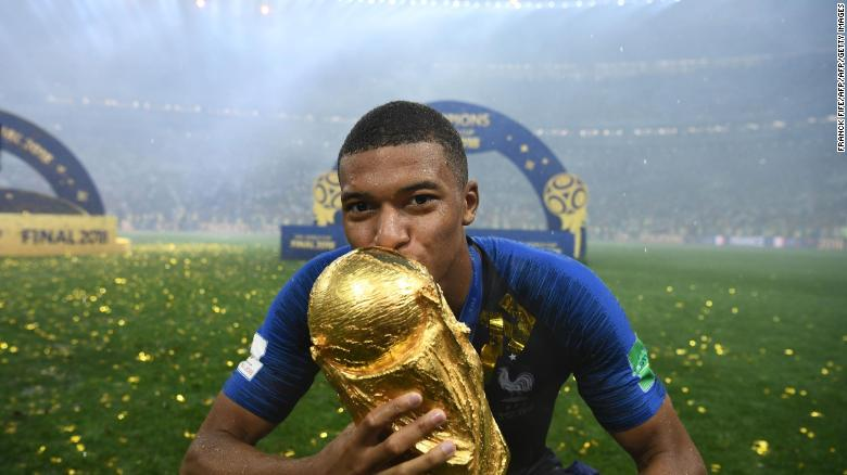 Kylian Mbappe  French mayor asks World Cup winner Kylian Mbappe to     Kylian Mbappe kisses the World Cup trophy after France  39 s win over  Croatia