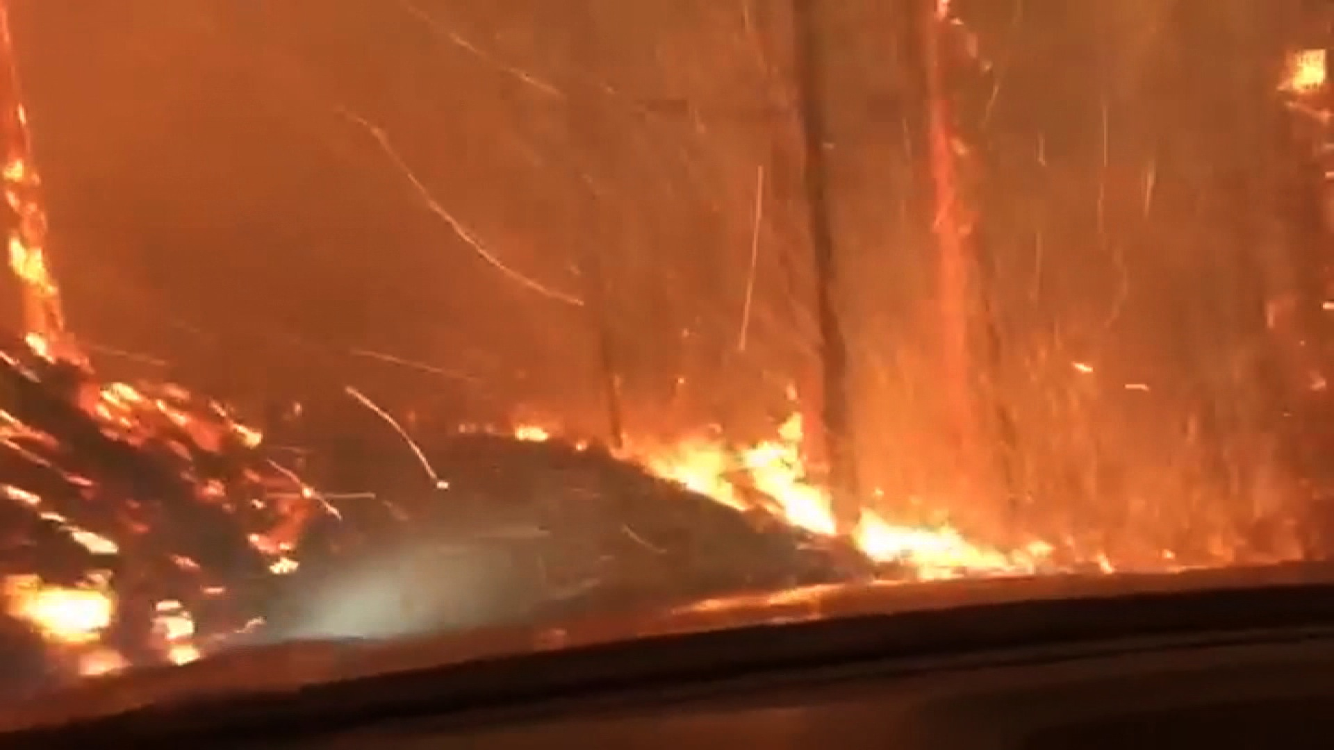 Father  son drive through fire to escape park   CNN Video