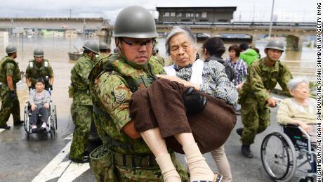 Patients of Mabi Memorial Hospital are rescued by Self-Defense Force members on July 8, 2018 in Kurashiki, Okayama, Japan.