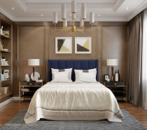 Standing in huge contrast to the last room, this space has a sophisticated buoyancy about it. The navy headboard in conjunction with the abstract geometric prints give this room a nautical vibe, like a particularly elegant stateroom on a ship.