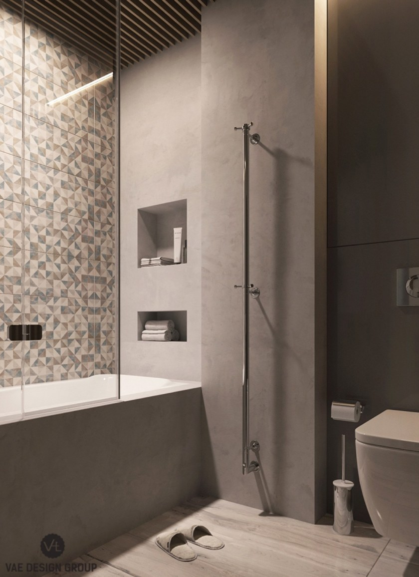 The ensuite binds bathroom duties to master bedroom colouring. Charcoal cabinetry and light wooden features are combined in multi-hued tiling. Slatted wooden ceilings and clever inlets ensure the contemporary feel is maintained.