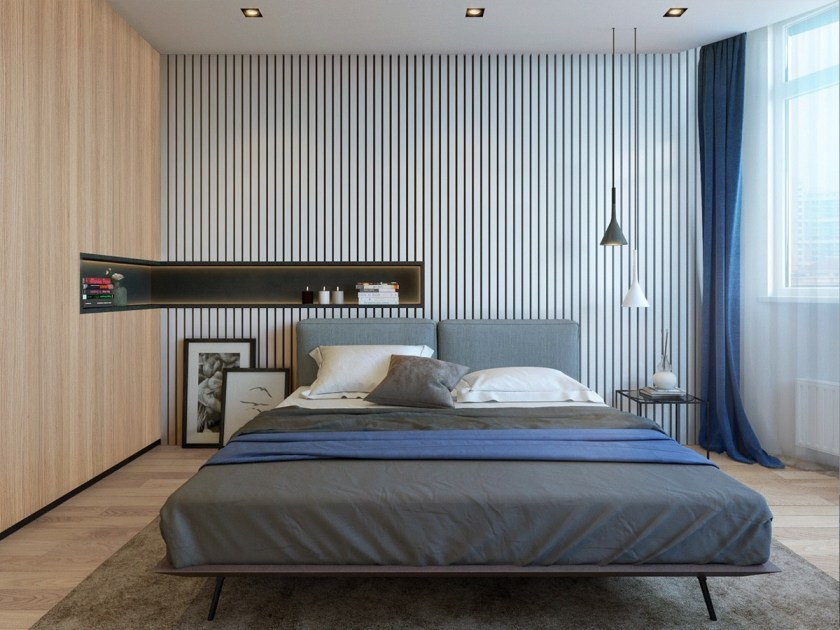 Twin minimalistic backgrounds create space and interest in the bedroom. A thin, horizontal wall inlet provides the space of a bedside table without the clutter, while midnight blue covers and rich terracotta upholstery adds warmth.