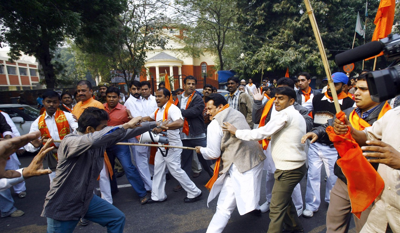 Indian Hindu and Muslim activists clash in New Delhi on an anniversary of the razing of The Babri Mosque in Ayodhya. Photo: AFP