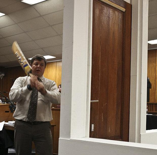 Cop beats down door with cricket bat