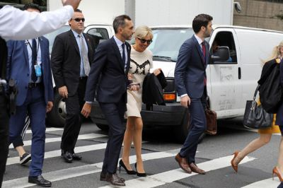 Brigitte Macron news: French first lady gives cheeky flash ...