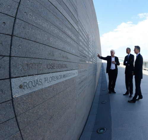 U.S. President Barack Obama (C) and his Argentine counterpart Mauricio Macri (R), next to a monument in Remembrance Park in Buenos Aires with the names of many of the 30,000 victims of forced disappearance under the 1976-1983 military regime. Mar. 24 marked the 40th anniversary of the start of the dictatorship. In his last official speech in the country, Obama criticised Washington's support for this and other de facto regimes in the region. Credit: Casa Rosada