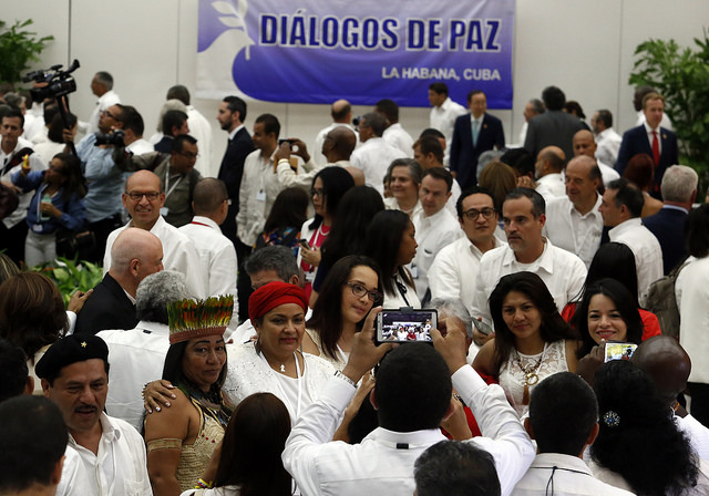 Victoria Sandino, a FARC commander, who headed the guerrillas' representatives to the gender subcommittee in the peace talks with the Colombian government (second-left, wearing red headscarf), poses with members of civil society during the signing of the definitive ceasefire on Jun. 23 in Havana, Cuba. Credit: Jorge Luis Baños/IPS
