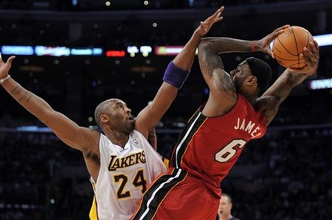 Los Angeles Lakers guard Kobe Bryant, left, fouls Miami Heat forward LeBron James during the first half of their NBA basketball game, Saturday, Dec. 25, 2010, in Los Angeles. (AP Photo/Mark J. Terrill)