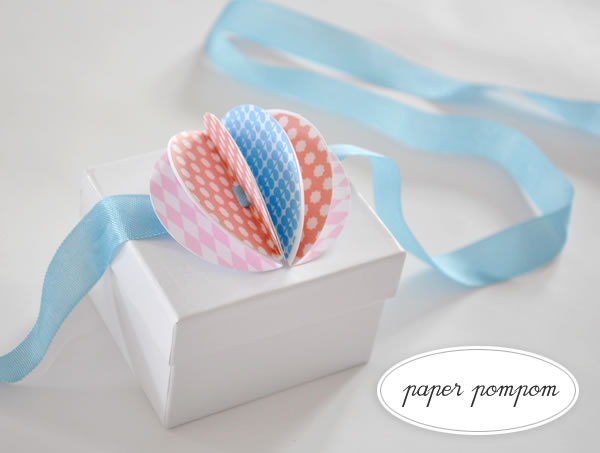 how_to_paper_pompom_toppers.jpg