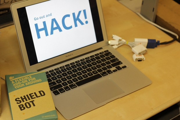 "Shieldbot box and laptop showing ""Get out and HACK!"""