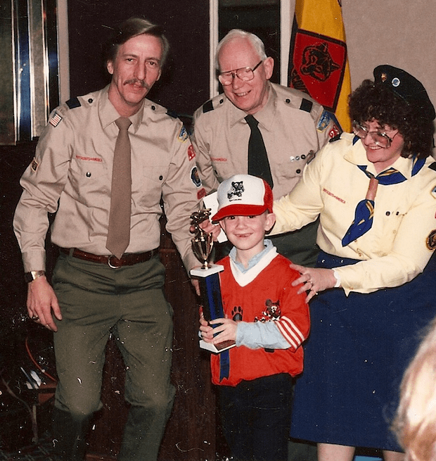 Winning the Pinewood Derby trophy.