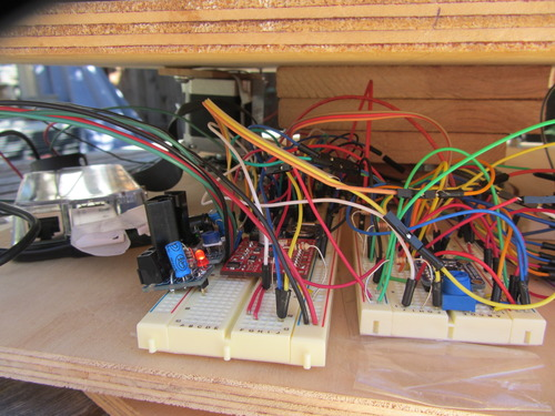 Raspberry Pi (left). Stepper motor driver and real time clock (middle). Analog to digital controller and voltage divider for temperature probes (right).
