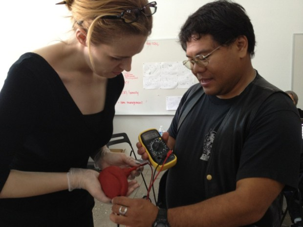 Annika O'Brien and Jay O'Balles testing the resistance of a conductive heart.