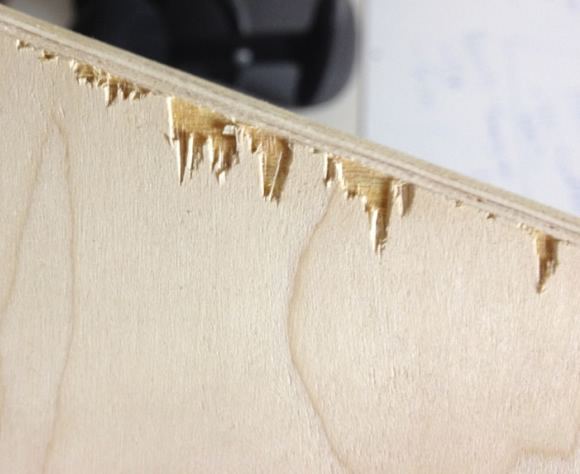 Plywood tearout caused by downcut chip ejection,
