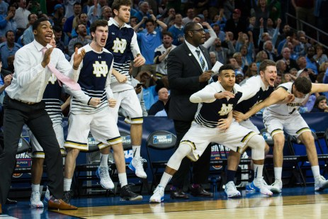The Irish bench celebrates in the closing seconds of Notre Dame's 61-56 win over Wisconsin on Friday night in Philadelphia.