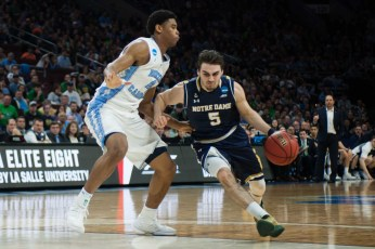 Sophomore guard Matt Farrell drives the lane during Notre Dame's 88-74 loss to North Carolina on Sunday in Philadelphia.