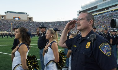 NDSP officer salutes the American Flag during the national anthem.