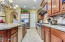 Oversized Island has sink and dishwasher with more granite counters