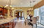 Upgraded staggered Cabinetry, SS High end KitchenAid Appliances with 3 ovens