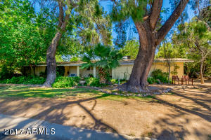 Beautifully situated on a large corner lot with mature trees