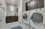 Nice size Laundry room with builtin Cabinets