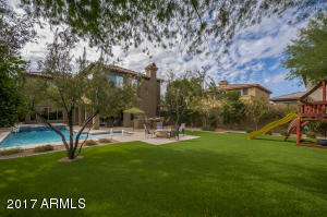 Stunning oversized lot with artificial turf.