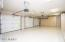 garage w/ epoxy floors and built in cabinets
