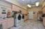Dream laundry room w/laundry sink & oodles of storage! Hobby/Craft corner too!