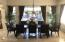 Formal Dining Room with Dramatic Views of Fountain and Backyard