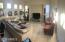 Bright Family Room with Surrounding Windows and Audio/Visual Entertainment Area
