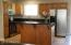 Kitchen island is breakfast bar on one side and extra storage on the other. Perfect for hosting parties and serving food.