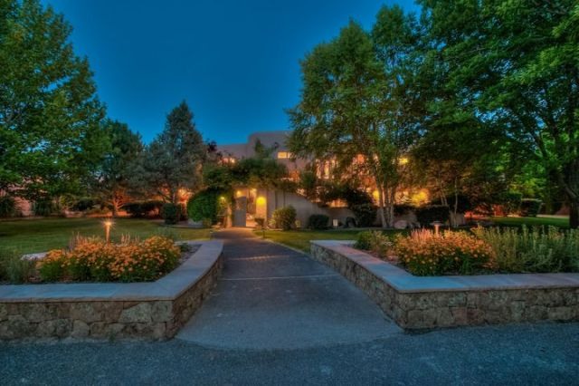 Grand entry to 6600 square foot masterpiece in desirable Tinnin Farms in the heart of Los Ranchos