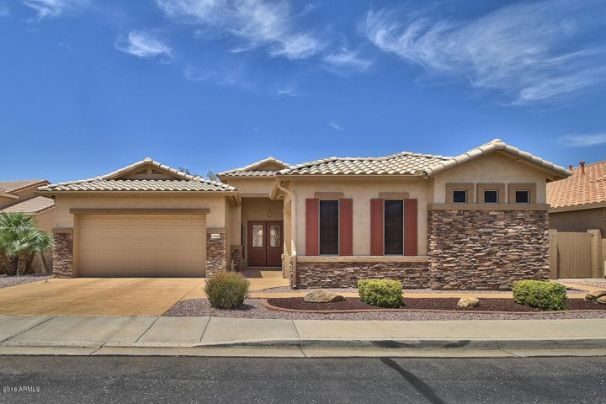 Welcome to our tour of 17698 W. Sammy Way located in the guard gated 55+ resort community of Arizona Traditions!
