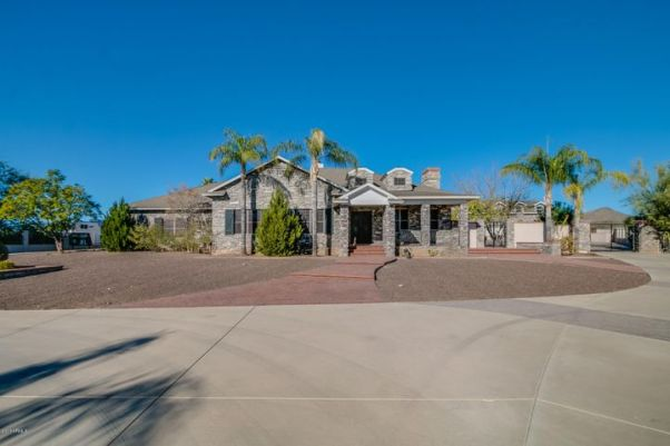 Long dramatic drive up to this custom equestrian estate
