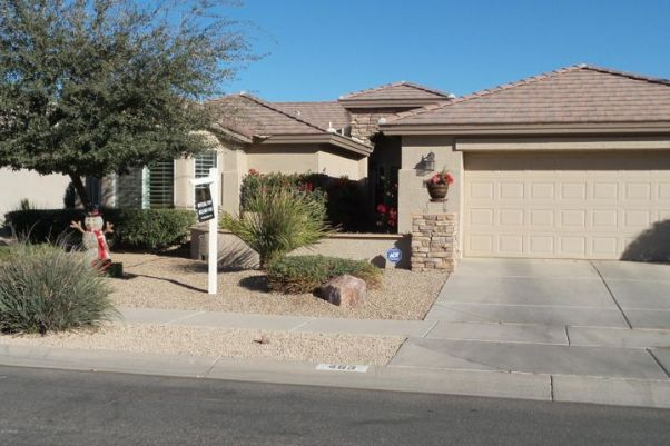 Front of this invititing home with rock trim and easy care professional landscaping.