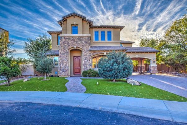 Front yard offers low maintenance artificial grass, paved walk way and low voltage lighting in front, side and back yard.