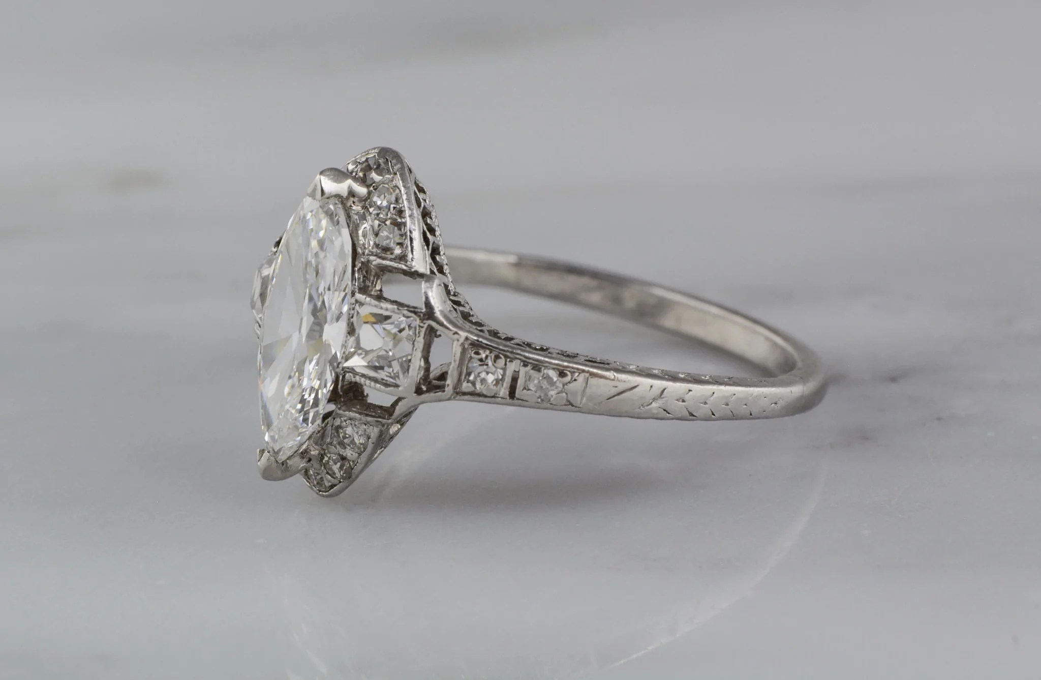 items sold page 7 art deco wedding ring 1 10 Carat Marquise Cut Diamond in Platinum Art Deco Engagement Ring with French Cut Diamond Accents R