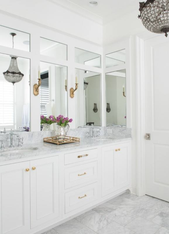 The master bath is a spa-like retreat. Jenna designed the custom millwork that encases the marble-topped vanity.