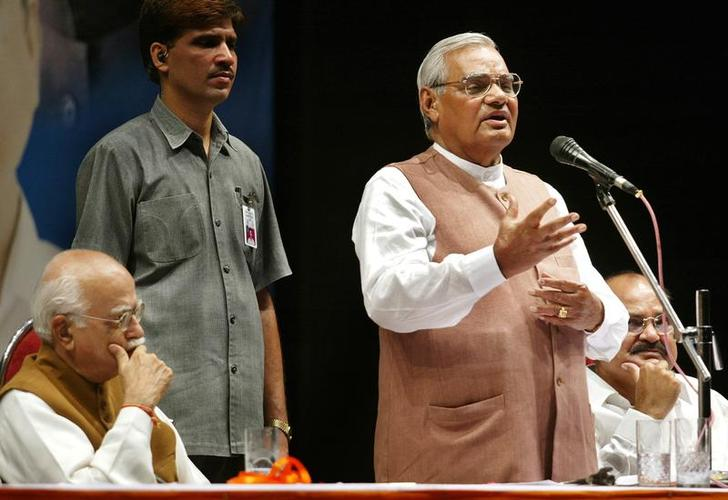 In this June 23, 2004 file photo, former PM Atal Bihari Vajpayee addresses BJP workers at a public meeting in Mumbai as former deputy PM L.K. Advani looks on. Credit: Reuters