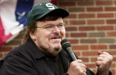 """BOSTON - JULY 27:  Filmmaker Michael Moore addresses a crowd of people who couldn't get inside a packed """"Take America Back"""" conference at the Royal Sonesta Hotel in Boston, Massachusetts. Moore was in Boston to appear at several events during the Democratic National Convention.  (Photo by Michael Springer/Getty Images)"""