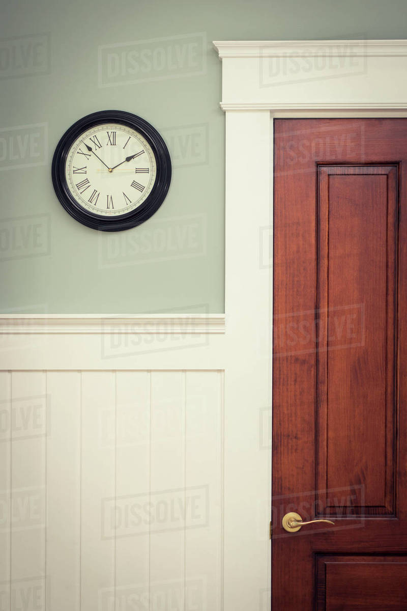Imposing Clock On Wall By Door At Home Clock On Wall By Door At Home Stock Photo Dissolve Clock On Wallpaper Clock On Wall Clipart furniture Clock On Wall
