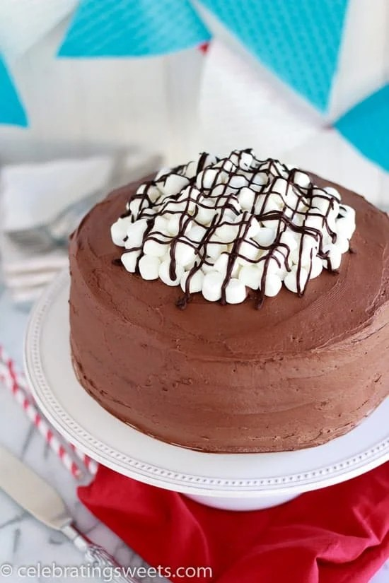 Chocolate Marshmallow Cake - Layers of chocolate cake filled with marshmallow frosting, topped with chocolate frosting, and finished with a pile of marshmallows.