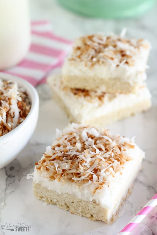 Frosted Coconut Sugar Cookie Bars - Soft coconut sugar cookie bars topped with vanilla cream cheese frosting and sweetened shredded coconut.